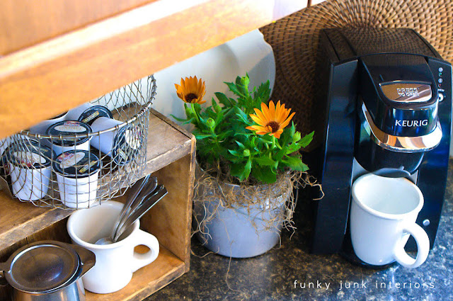 Coffee pod storage with a crate and a basket via http://www.funkyjunkinteriors.net/