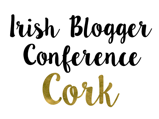 "Black text reading ""Irish Blogger Conference"" Gold foiled text reading ""Cork"""