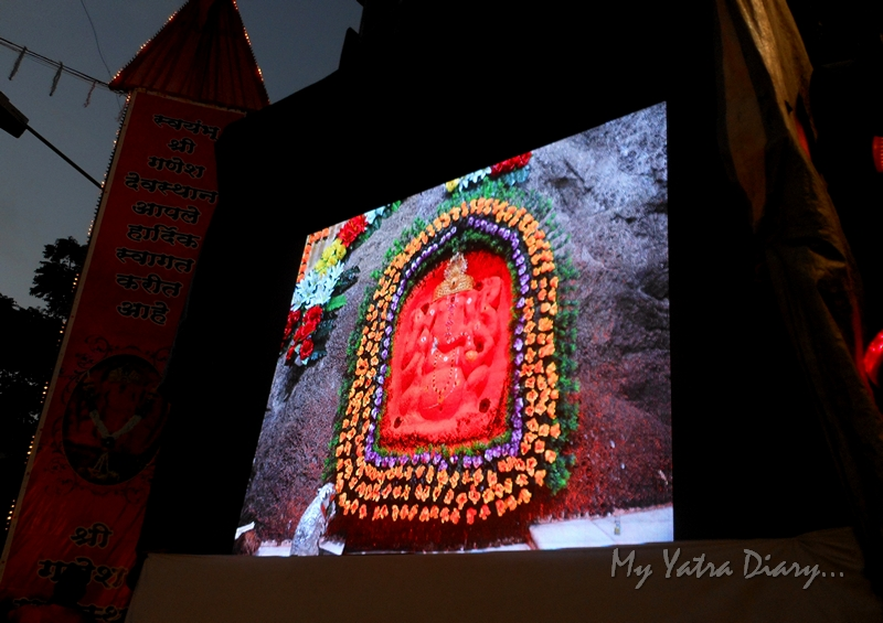 A TV display of Ganesha during the festival of Ganesh Visarjan, Mumbai