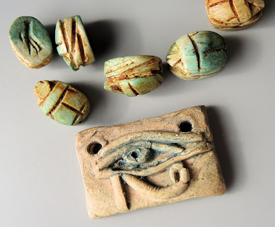 Eye of Horus focal by Scorched Earth, various scarabs.