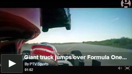 http://funkidos.com/videos-collection/amazing-videos/giant-truck-jumps-over-formula-one-car