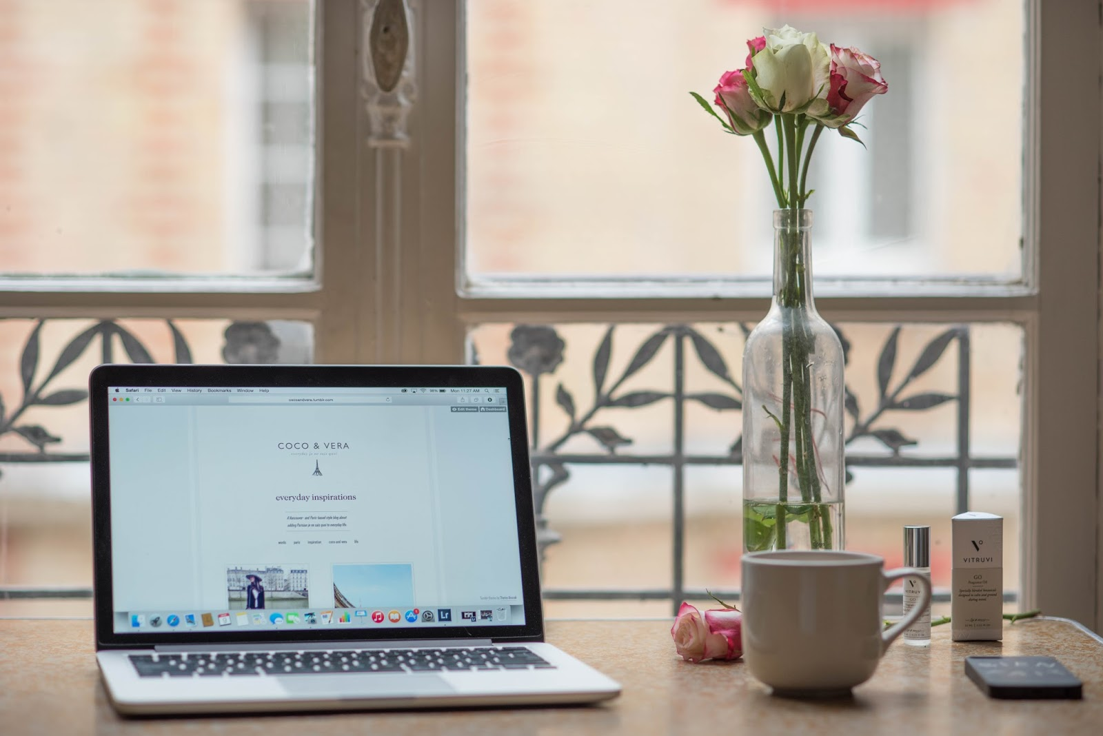 coco and vera, top paris travel blog, vitruvi go aromatherapy oil, macbook air, roses, madewell bien fait iphone case, work space