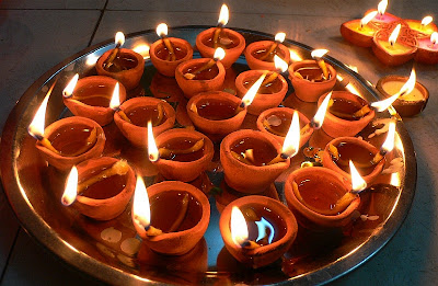 A tray full of litearthen diyas on the night of the Diwali pujan