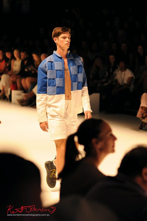 Menswear, bold blue check jacket (square) white shorts. Matiny Ng's 580 fashion label at MBFWA Raffles International Showcase, Carriageworks Sydney. Photographed by Kent Johnson.