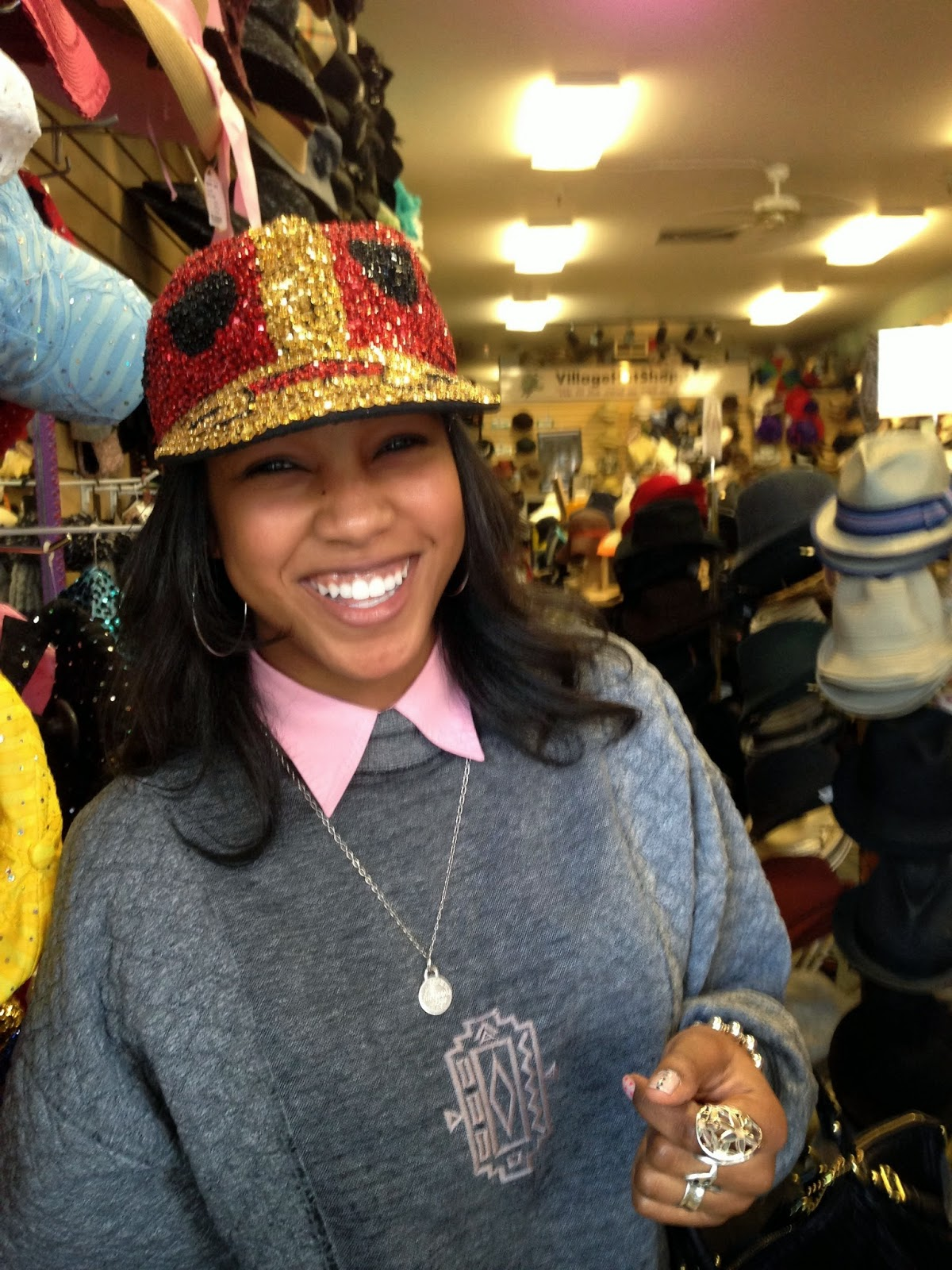Wearing sequined ladybug hat and Tiffany & Co necklace