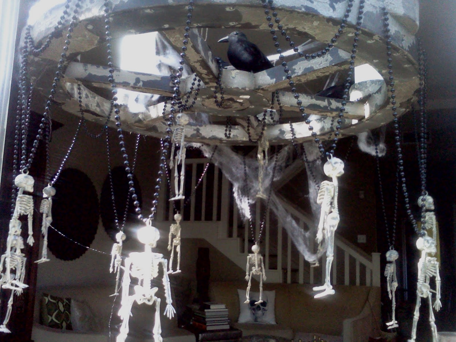 dem bones halloween chandelier use existing chandelier or make styrofoam wood toy wagon wheel etc hang dollar store skeleton necklaces from