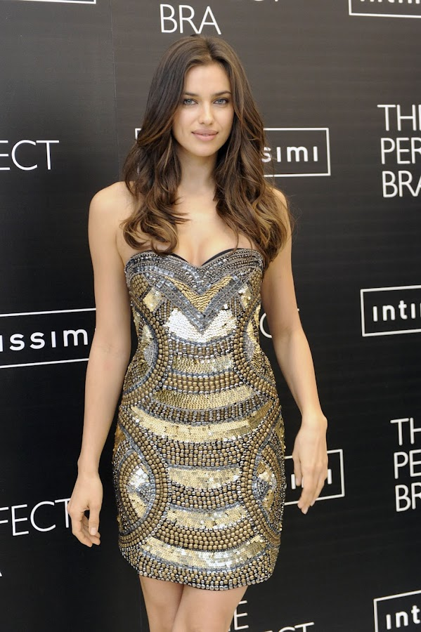 Irina Shayk ia a dress that shows off her curvy cleavage