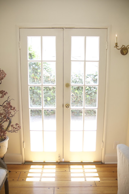Living Room in the Nest; French Doors and sunlight; Nora's Nest