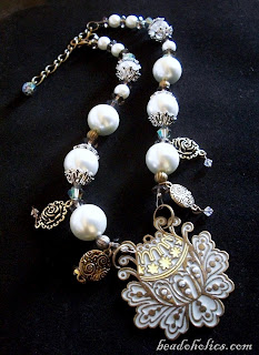 stunning necklace from beadoholics.com - glass pearls, faceted beads, austrian crystals and metal charms