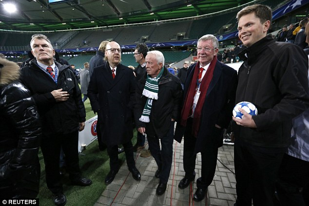 Sir Alex Ferguson (second right) and Manchester United co-owner Avram Glazer (second left) were among those kept on the pitch after a security scare at the end of the game
