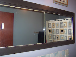 Bathroom Built in a huge mirrored cabinet.