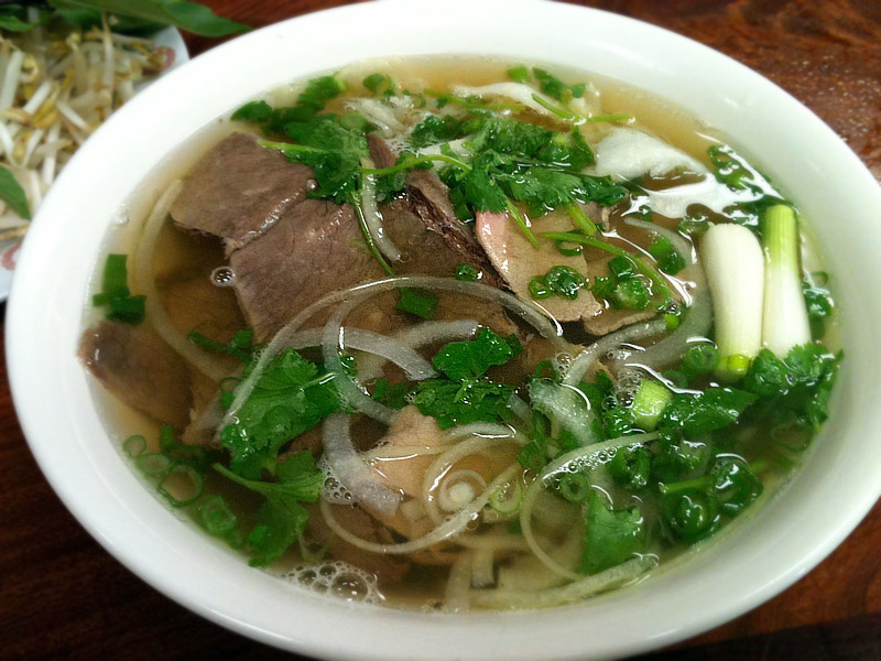 Place broth onto a bowl and add in cooked vermicelli and garnishes ...