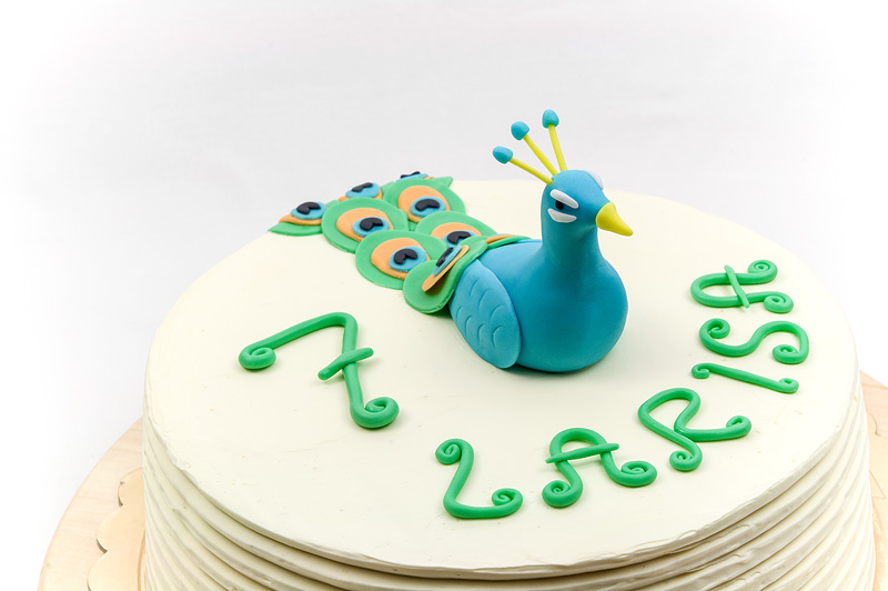 Peacock cake fondant figurine close up
