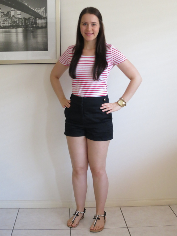 Red striped t-shirt, black shorts, sandals and gold jewellery