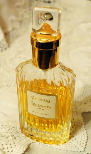 A bottle of Grossmith Phul-Nana standing on vintage table linen
