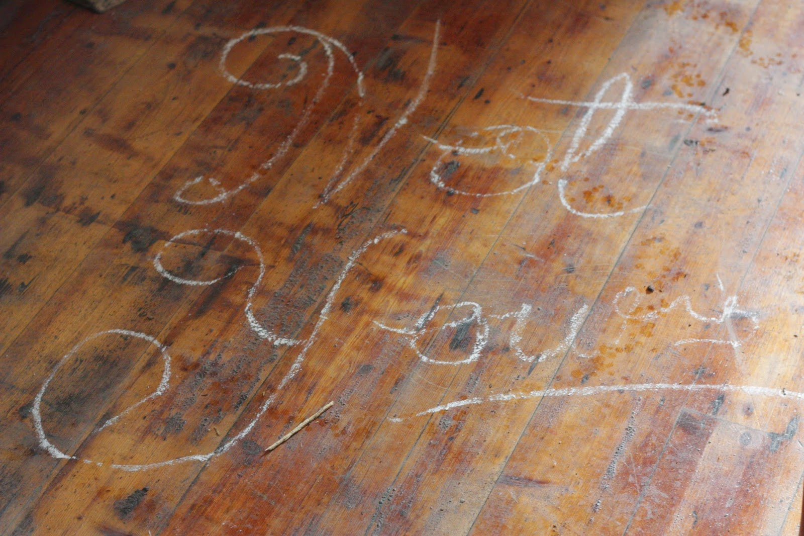 'not yours' scrawled on the floor in chalk