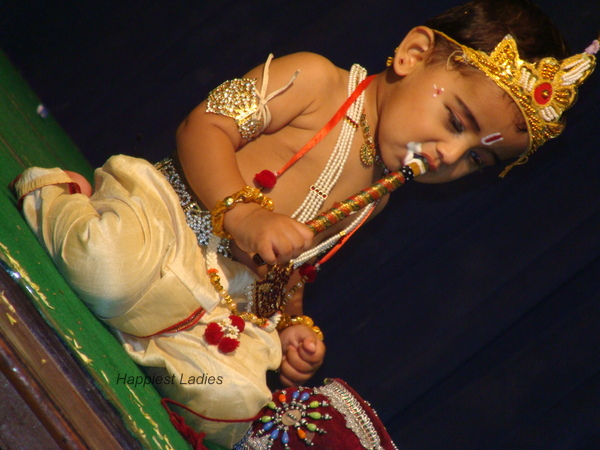 Krishna eating butter with flute