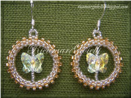 orecchini cerchio in peyote e farfalle swarovski