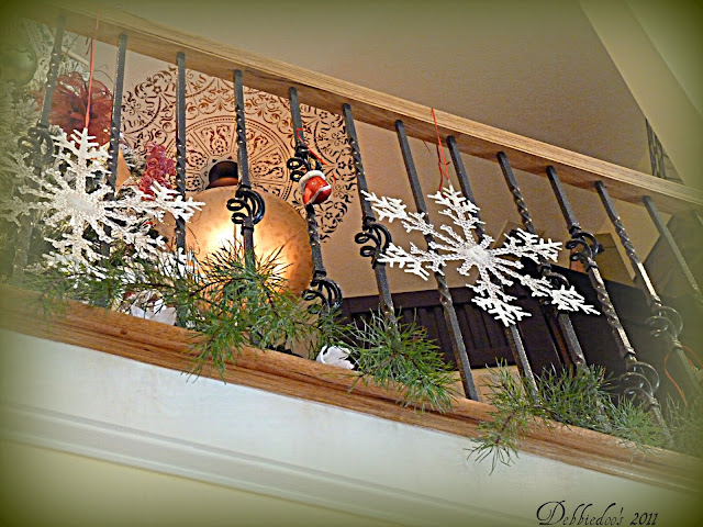 ba Decorating the banister for the Christmas Holiday!