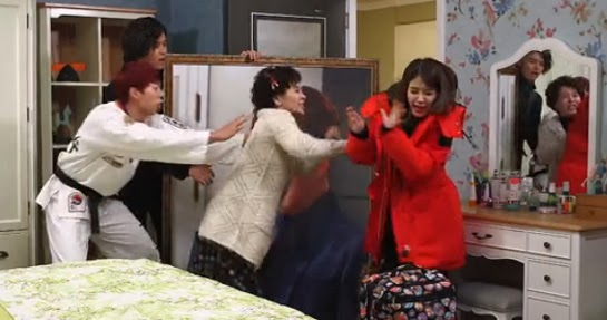 Yeo Hoo Min (from U-KISS) as Kim Dae Shik tries to hold back Lee Mi Young as Lee Mal Ja as she attacks Bo Tong. David watches the scene unfold.
