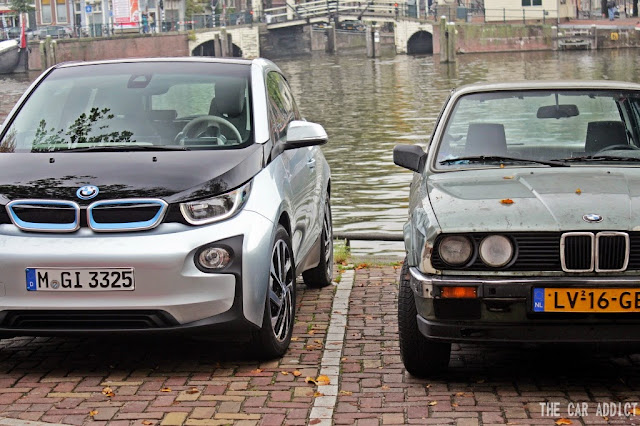 silver BMW i3 and old BMW E30 in Amsterdam
