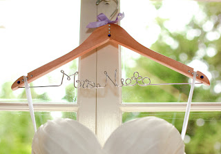 Mrs. Nieto add to Patricia's hanger for her wedding dress