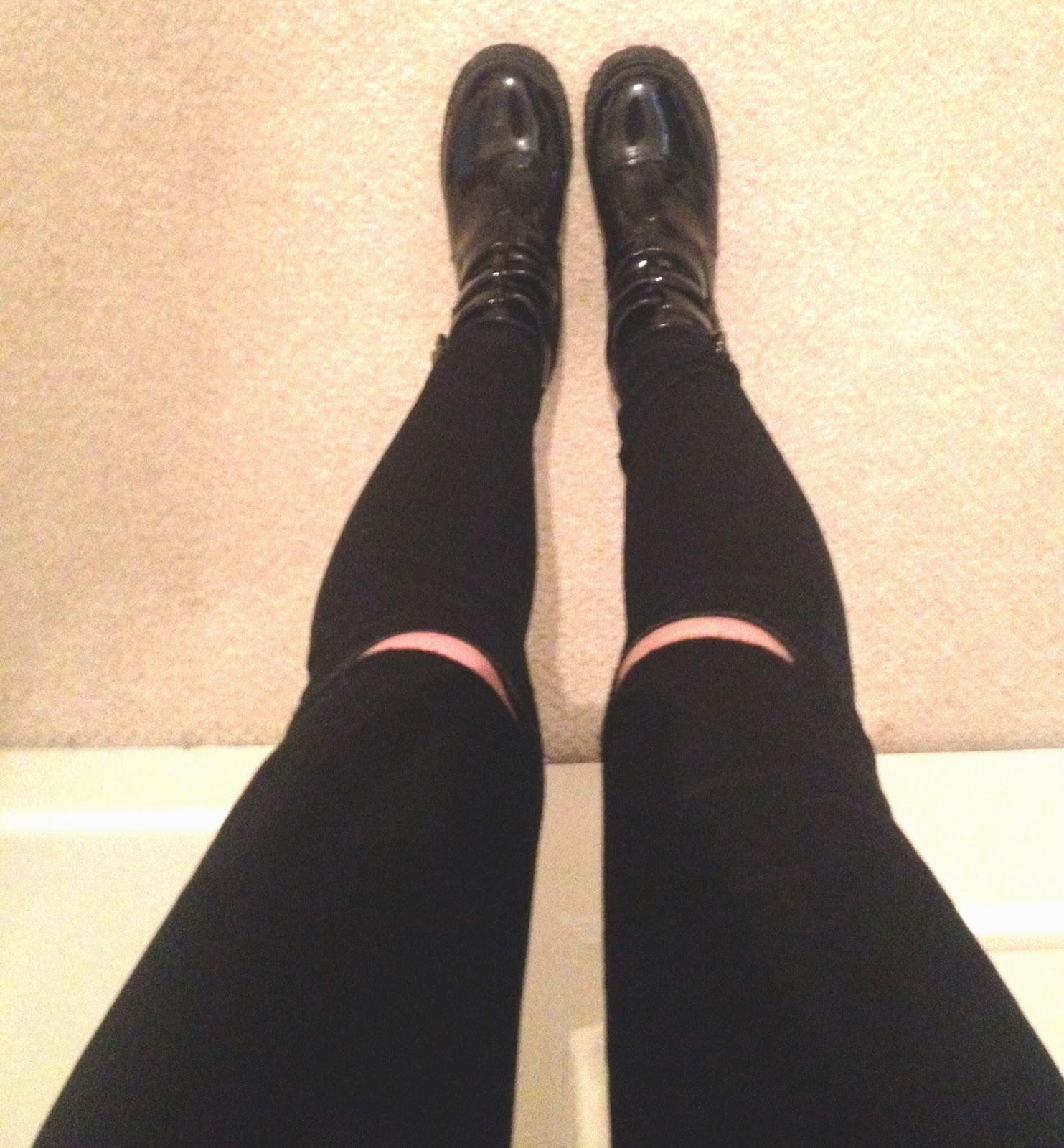 ribbed black jeans and chunky boots from above