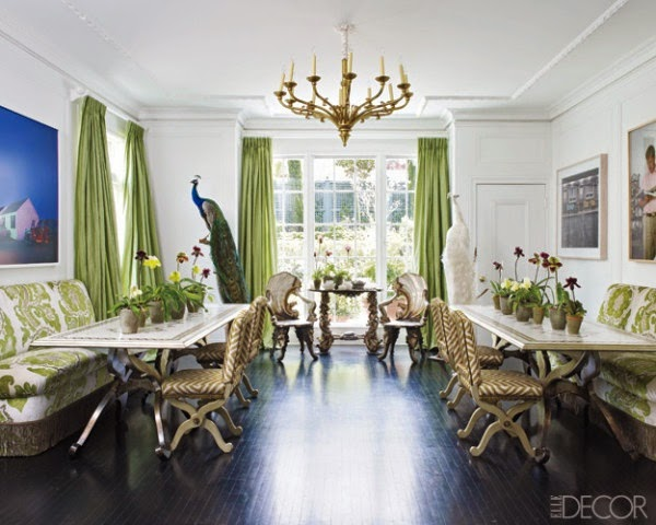 dining room with two tables dark wood floors banquette green and white