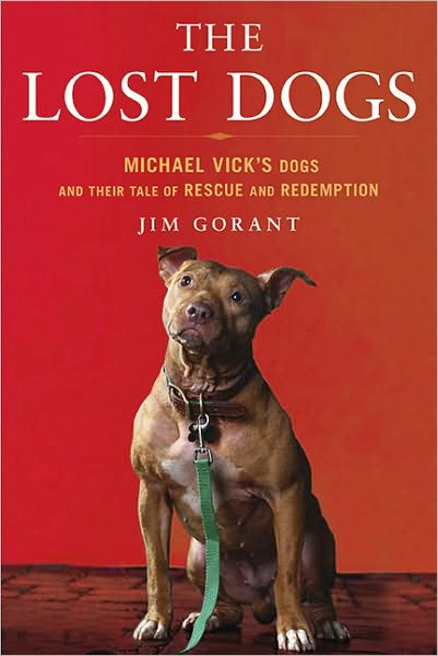 book cover of The Lost Dogs, featuring a reddish very muscular pit bull