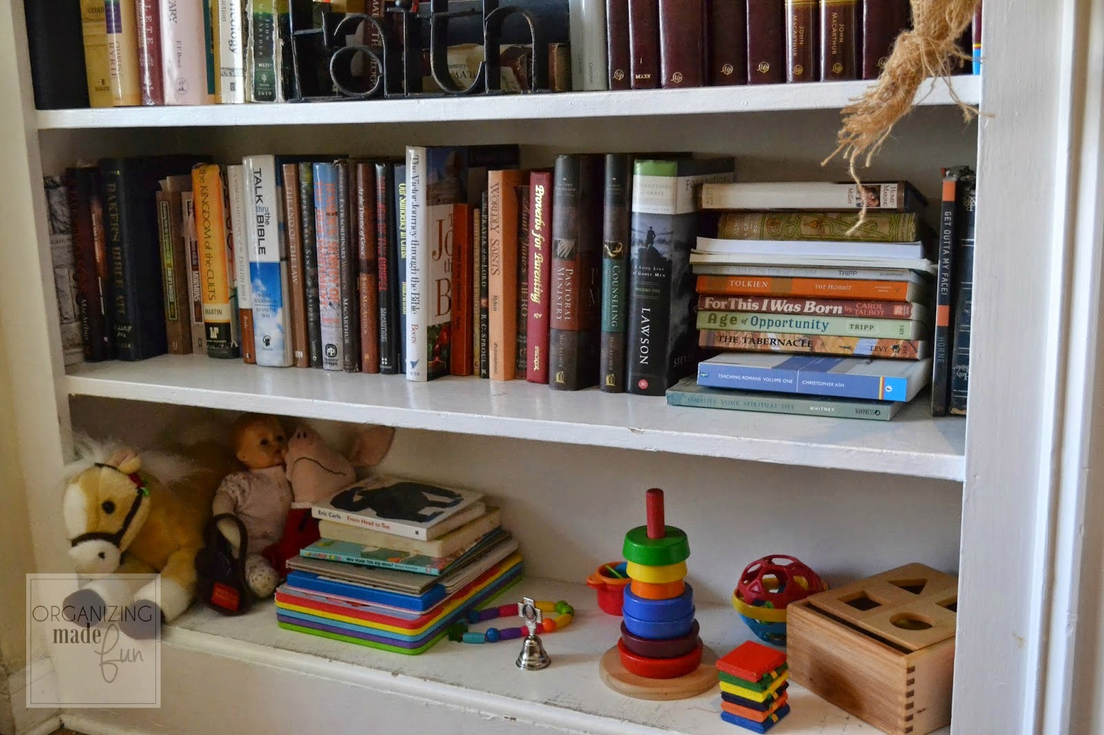 Clear off a lower shelf for your toddler to keep their toys :: OrganizingMadeFun.com