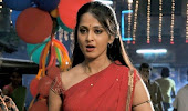Anushka pics from vaanam song in red saree