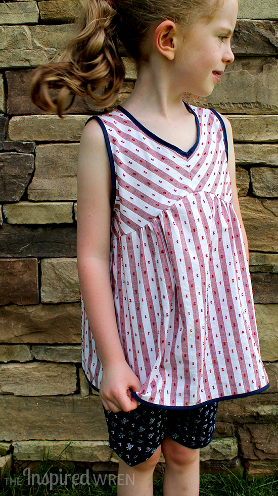 Cut yoke stripes on the bias for a classic striped blouse. Sewing pattern from Sew Chic Kids | The Inspired Wren