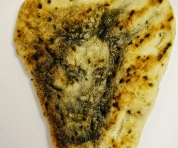 Cristo num pão indiano