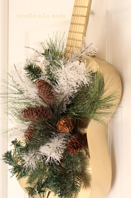 "Christmas ""wreath"" made with a guitar sprayed gold"