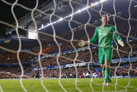Manchester City goalkeeper Joe Hart reacts after conceding a late goal to Chelsea