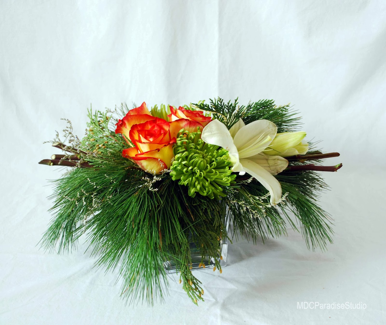 PARADISE FLORAL STUDIO Christmas Flower Arrangements