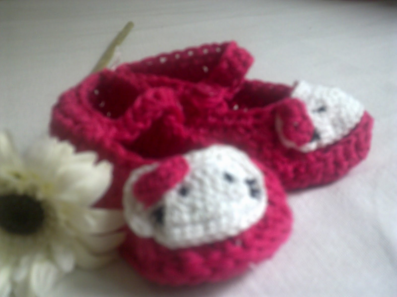 Hand-knitted booties and hats for kids