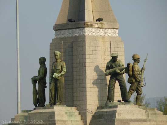 Statues representing the Air Force, Bureaucrat, Navy and Army at Victory Monument, Bangkok