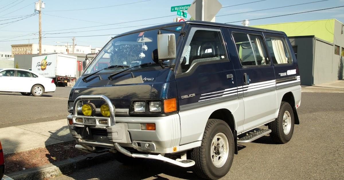 OLD PARKED CARS.: 1993 Mitsubishi Delica Chamonix.
