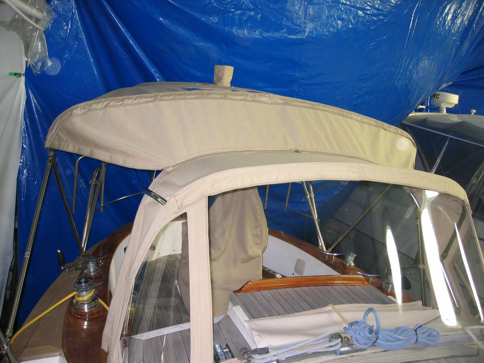 Homestyle Custom Upholstery and Awning: Tan Boat Tops