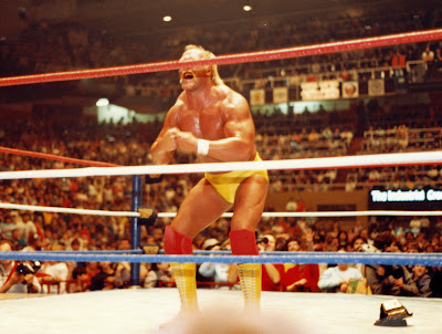 In the middle of the Maple Leaf Gardens wrestling ring, WWF Champion Hulk Hogan demonstrates his 'most muscular' pose in his red and yellow outfit.