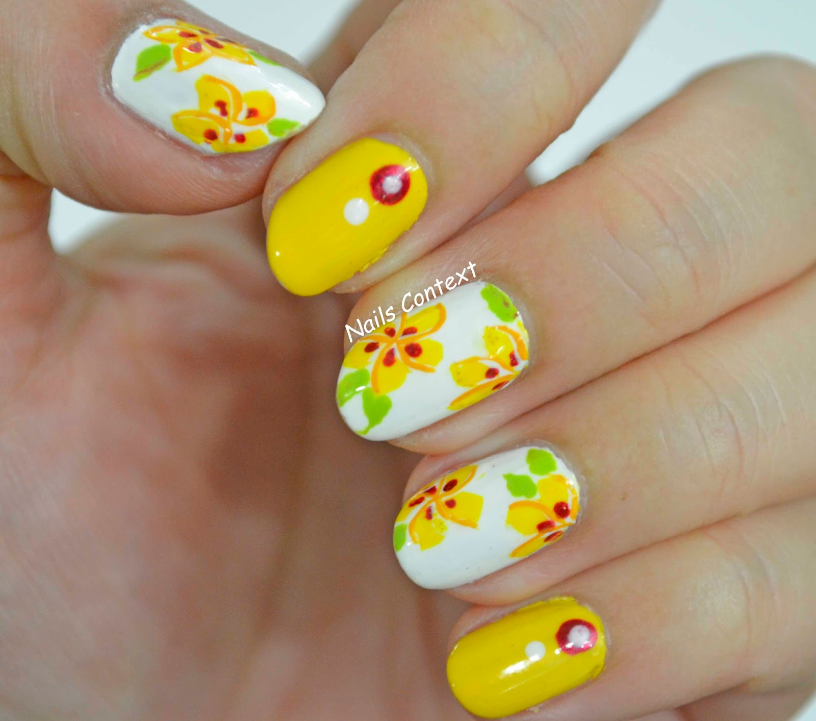 Nails context hawaiian flowers couldnt help but take picture of my nails with some of my favorite hawaiian flowers white plumeria and yellow hibiscus izmirmasajfo