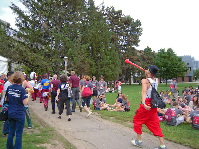 A engineering Welcome Week rep marches alongside the McMaster marching band with his vuvuzela.