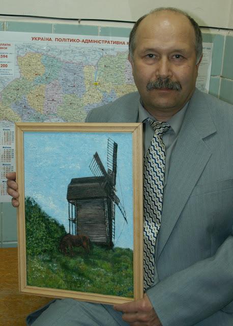 Виталий Бабенко с картиной