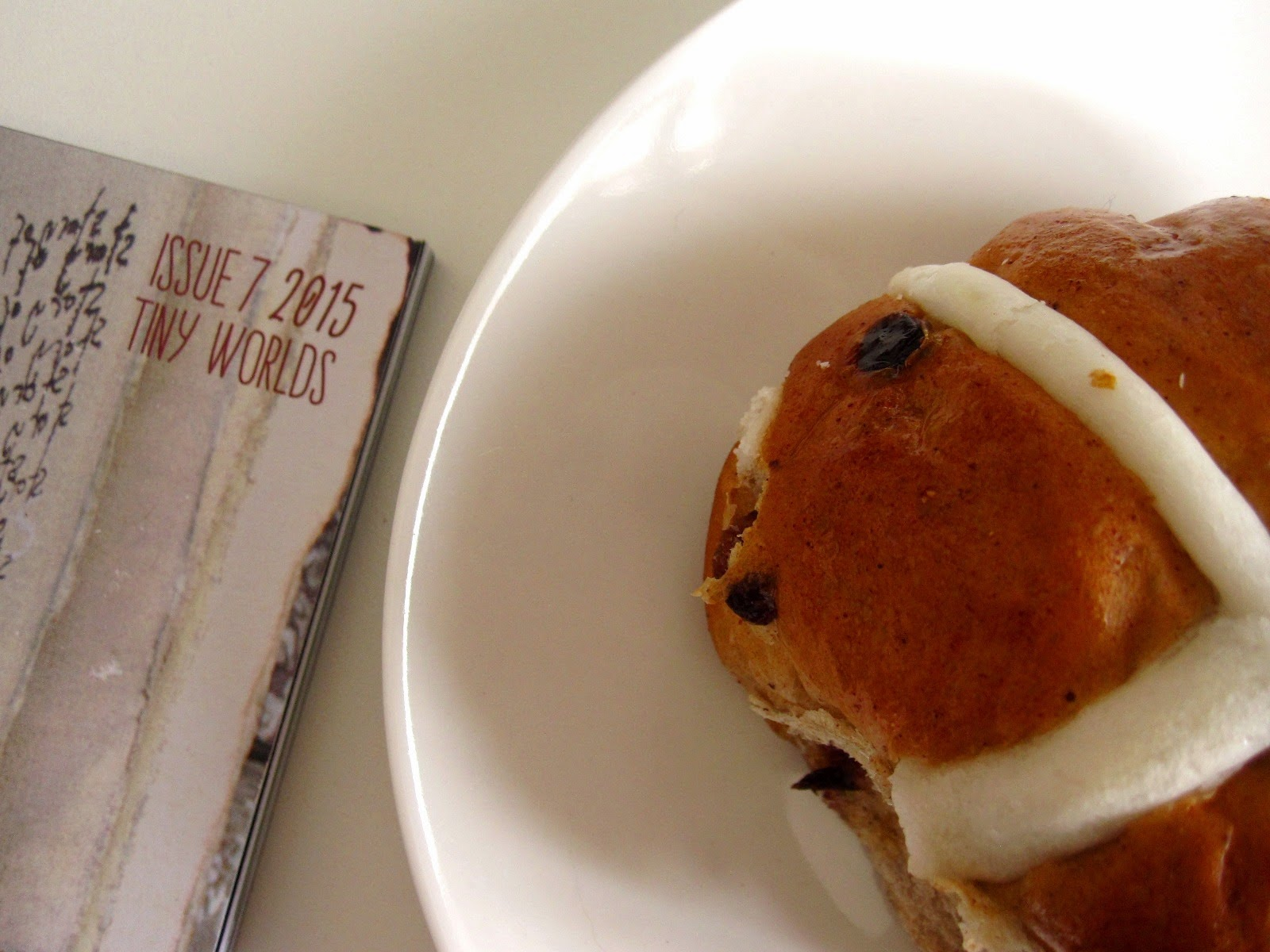 Magazine with 'Issue 7 205: Tiny worlds' written on the cover, next to a mini hot cross bun on a saucer.
