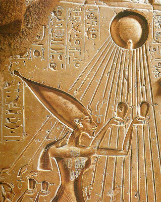 Akhenaten and Nefertiti praying to the sun-god Aten
