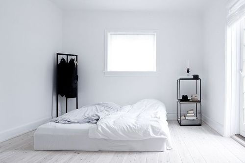 Minimalism in the age of excess culturecrit for Minimalist black and white bedroom