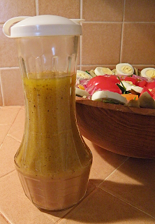 Bottle of Homemade Dressing with Salad in Background
