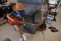 Barefoot Boys Playing Guitar