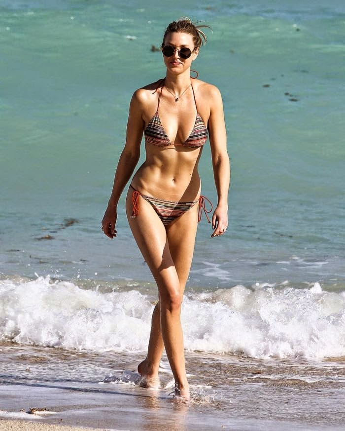 Whoops! Whitney Port knew the risks of wearing of a tw0-piece before she jumped to the crystal water of ocean at Miami, FL, USA on Thursday, December 4, 2014.